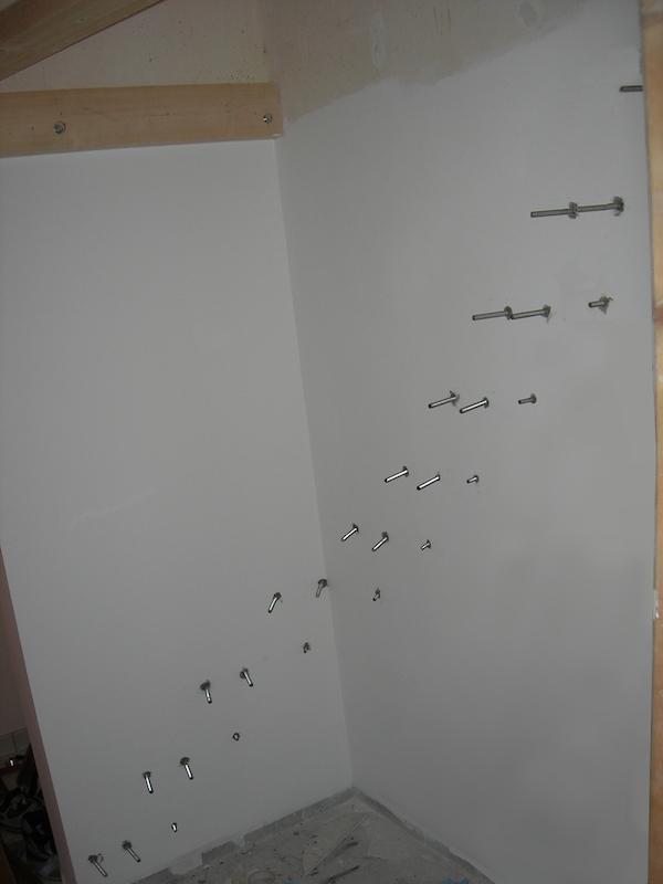 Préparation du mur porteur pour recevoir un escalier quart de tour suspendu
